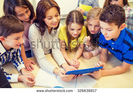 stock-photo-education-elementary-school-learning-technology-and-people-concept-group-of-school-kids-with-326638817 1